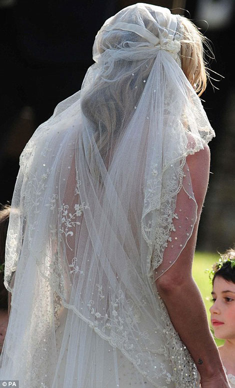 kate moss wedding dress by john galliano veil